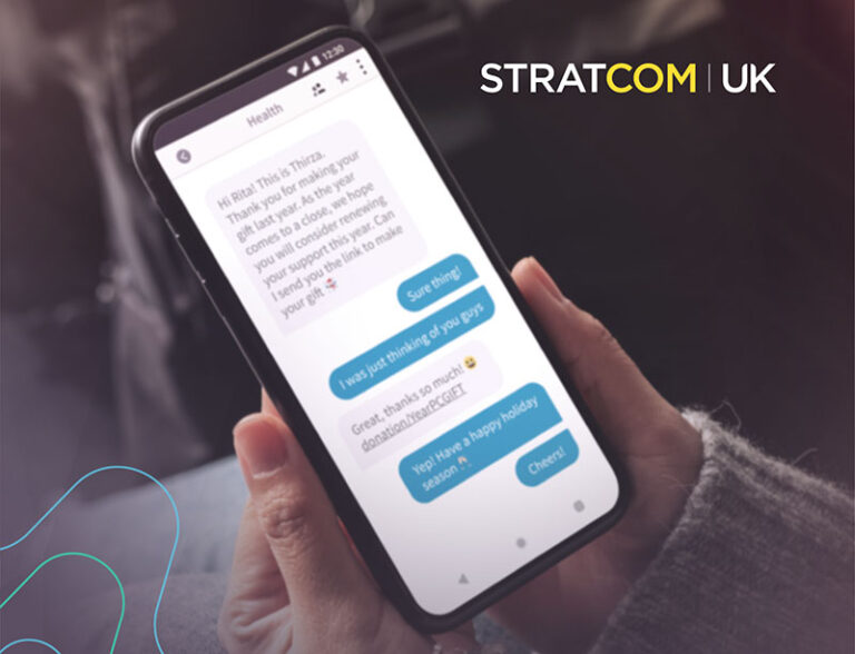 Messaging on a mobile phone, with Stratcom UK logo