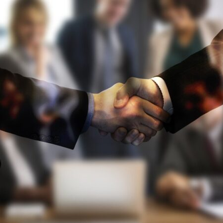 People in a business meeting shaking hands Image by Gerd Altmann from Pixabay