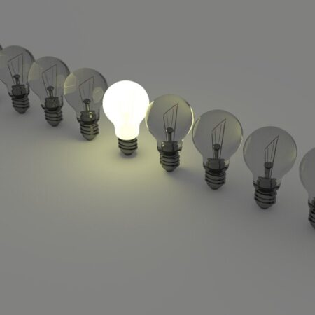 One lit up lightbulb in a row of others Image by Colin Behrens from Pixabay