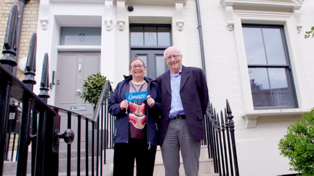 Marilyn and David Pratt outside the prize draw house in London