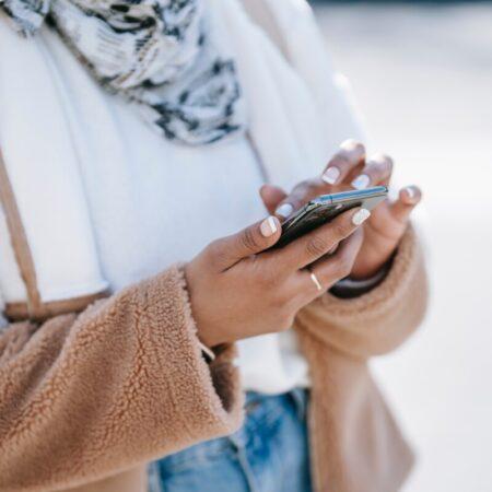 Woman texting by Keira Burton Pexels