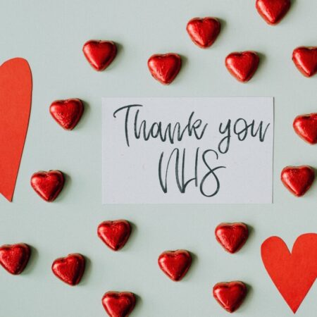Written 'thank you NHS' message amongst red love hearts - photo: Pexels.com