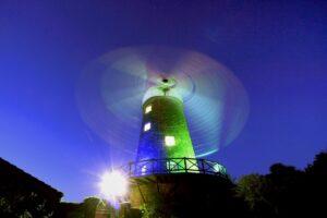 Greens Windmill at night lit up by Jamie Duff Greens Windmill Trust