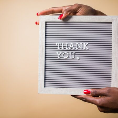A woman's hands holding a thank you sign by pexels rodnae productions