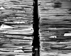 Piles of files (black and white photo). Image: Pixabay.com