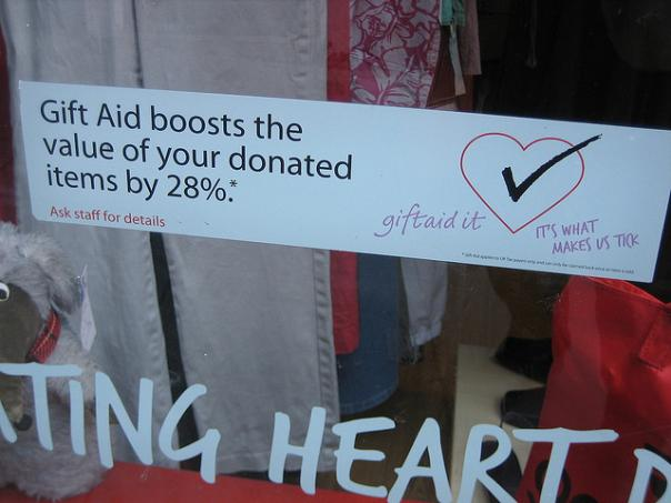 Gift Aid promotion in the window of a British Heart Foundation shop. Photo: Howard Lake
