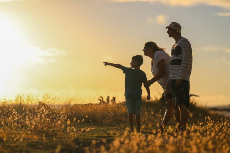 a family walking in the sunset