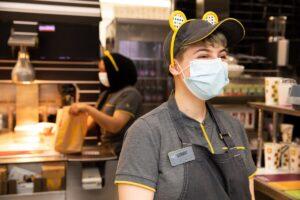 A McDonald's worker wearing Pudsey bear ears