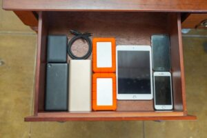 Drawer-full of unwanted mobile phones and devices. Photo: Vodafone