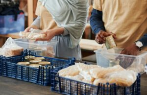 two people sorting food donations