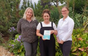 Three women from St Barnabas hospice with the award won for their Covid Donation Drive Thru