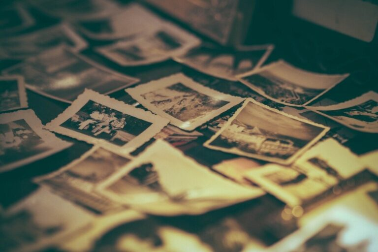a pile of black & white photos